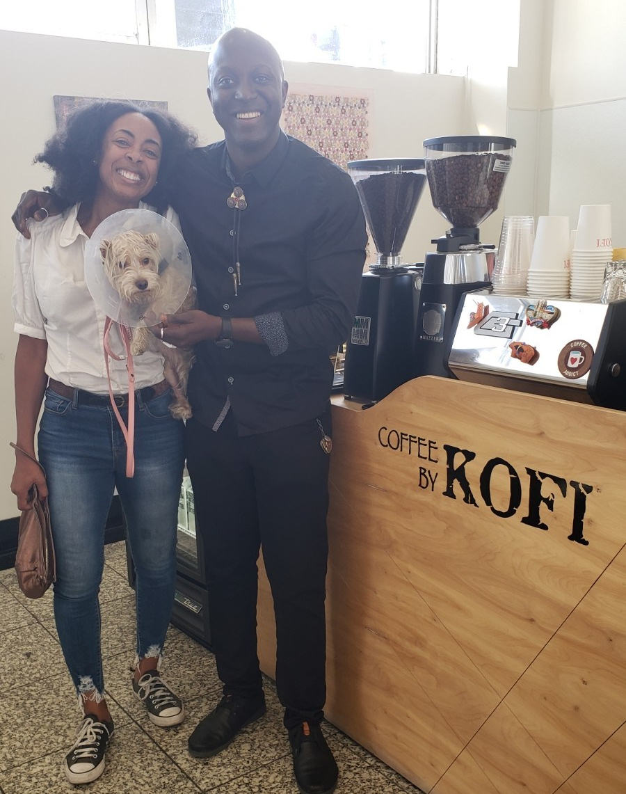 This is Kofi of Coffee by Kofi The Reef | LA Mart, 1933 S Broadway https://www.coffeebykofi.com/ Coffee is bomb and he also designs coasters and the tie he's wearing out of fab buttons!